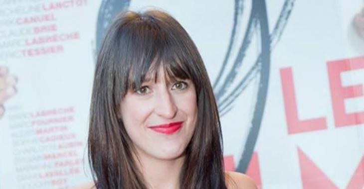 Anne-Élisabeth Bossé fait tourner bien des têtes dans sa magnifique robe sur le tapis rouge de 9, le film.